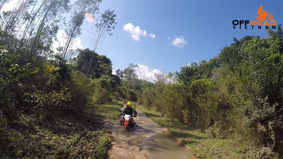 Vietnam Motorbike Motorcycle Tours - Ho Chi Minh Trail Motorbike Tour on a dirt track.