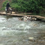 Riding over a bamboo bridge set up when the water is low