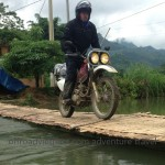 Cool riding style over a bamboo bridge set up when the water is low