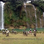 A group of dirt bike riders at Ban Gioc waterfalls of Cao Bang province